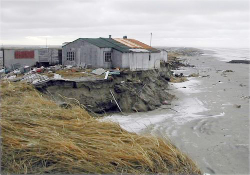 house on edge of eroding coastline