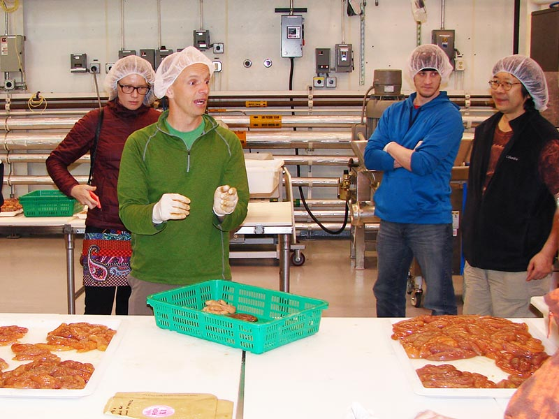 Instructor addressing students in seafood processing lab