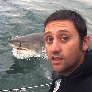 Thomas Farrugia with a shark in the background