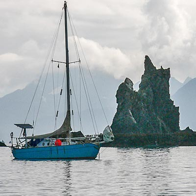 sailboat with rock formation